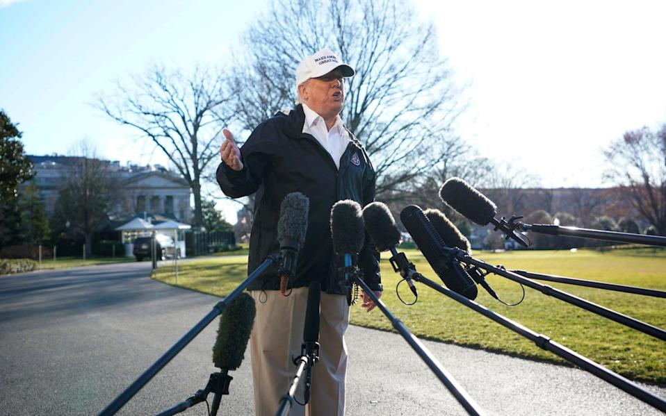 Donald Trump, speaking outside the White House. The FBI arrested a man on Wednesday who planned to attack the building on Thursday - REUTERS