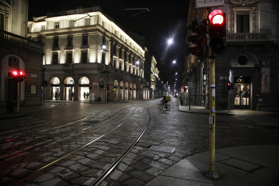 Streets are empty in Milan, northern Italy, early Sunday, Oct. 25, 2020. Since the 11 p.m.-5 a.m. curfew took effect last Thursday, people can only move around during those hours for reasons of work, health or necessity. (AP Photo/Luca Bruno)