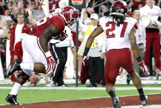 Alabama running back Jalston Fowler (45) catches a pass and beats Arkansas safety Alan Turner (27) to the corner for a touchdown during the first half of an NCAA college football game on Saturday, Oct. 19, 2013, in Tuscaloosa, Ala. (AP Photo/Butch Dill)