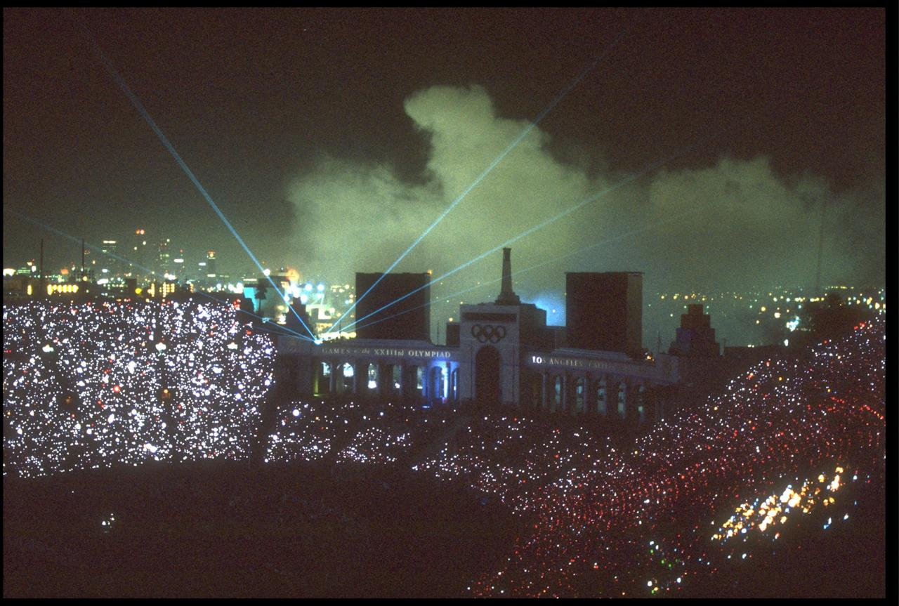 12 AUG 1984: A LASER SHOW ILLUMINATES THE SKY DURING THE CLOSING CEREMONY OF THE 1984 OLYMPIC GAMES HELD IN THE LOS ANGELES MEMORIAL COLISEUM.