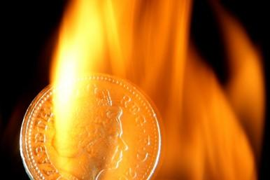 Pound coin in flames