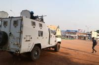 A MINUSCA armoured personnel carrier keeps guard while patroling the streets ahead of the upcoming elections in Bangui