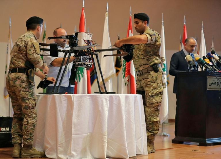 Lebanese soldiers display an alleged Israeli drone that fell in a southern Beirut suburb last month