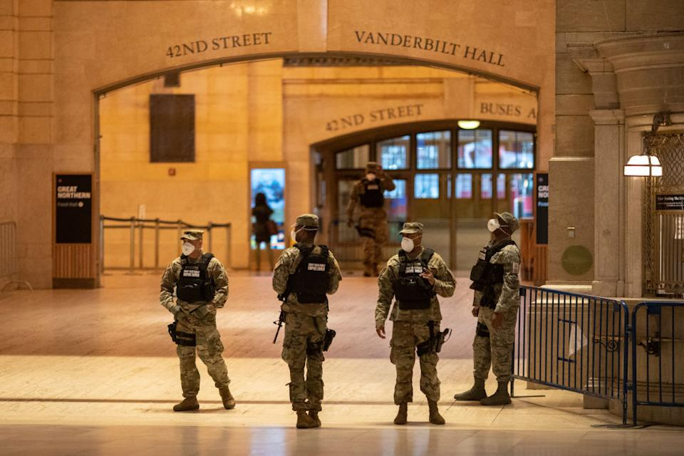 Members of the US Army National Guard wearing protective masks seen at Grand Central Station in New York. Source: Getty