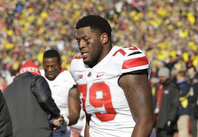 Ohio State offensive linesman Marcus Hall (79) walks the sidelines after being ejected from the game during the second quarter of an NCAA college football game against Michigan in Ann Arbor, Mich., Saturday, Nov. 30, 2013. The third-ranked Buckeyes lost Hall and kick returner Dontre Wilson and the Wolverines lost backup linebacker Royce Jenkins-Stone to ejections. All three players were flagged for unsportsmanlike conduct and had to leave the field after a skirmish. (AP Photo/Carlos Osorio)
