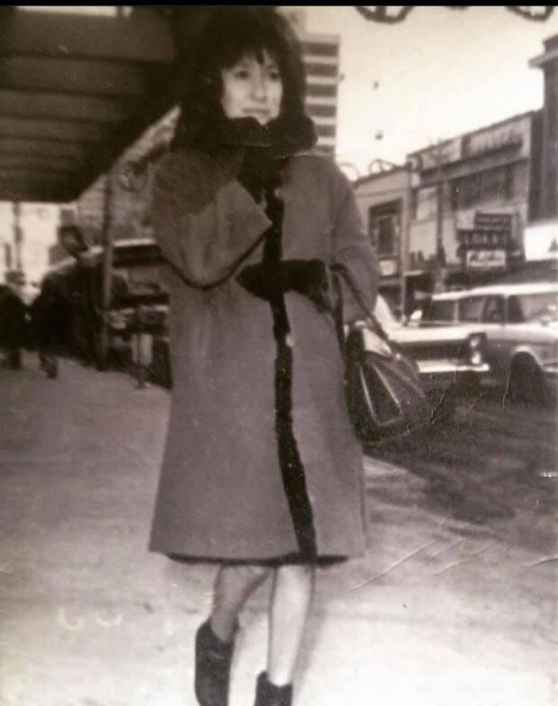 Yamkovy's late mother, Emmy Yamkovy, walking down an Edmonton street, in black and white.