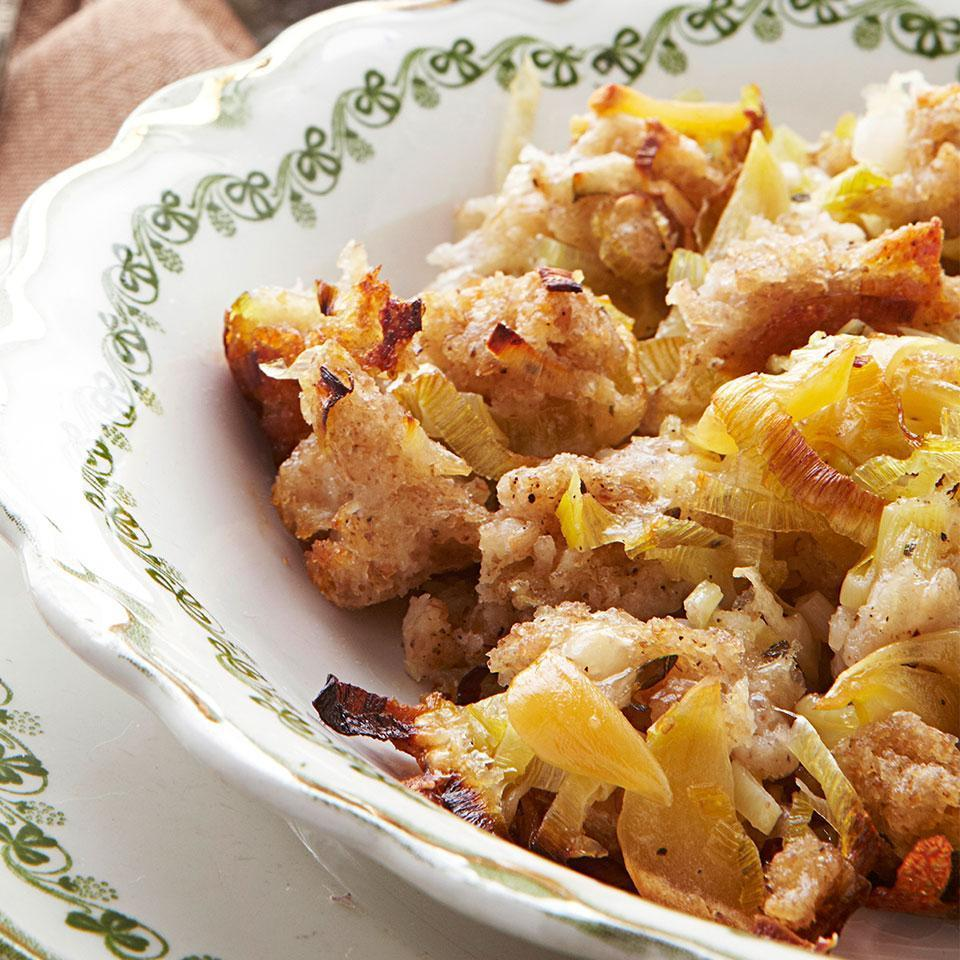 """<p>This stuffing-like vegetable-and-bread casserole recipe is inspired by the vegetable tians of Provence. The soaked stale bread binds leeks, nutty raclette cheese, abundant roasted garlic and thyme. Serve with roast chicken and a green salad to make a swoon-worthy meal. <a href=""""http://www.eatingwell.com/recipe/250815/roasted-garlic-leek-bread-casserole/"""" rel=""""nofollow noopener"""" target=""""_blank"""" data-ylk=""""slk:View recipe"""" class=""""link rapid-noclick-resp""""> View recipe </a></p>"""