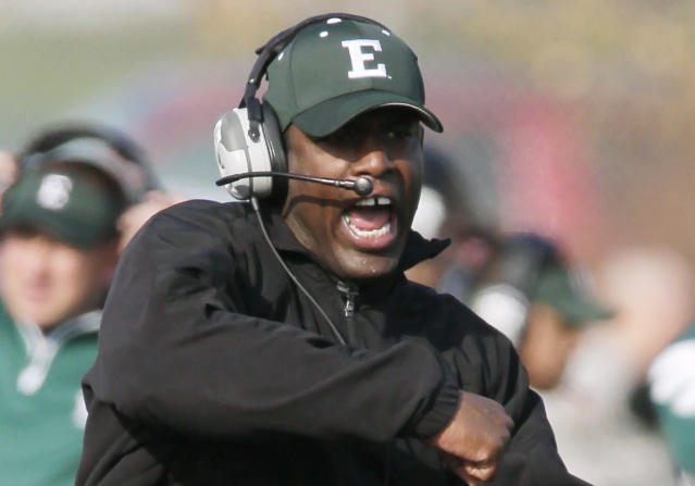 File - In this Nov. 11, 2012, file photo Eastern Michigan head football coach Ron English reacts after the Eagles recovered a fumble during an NCAA college football game against Central Michigan in Ypsilanti, Mich. In a statement Friday, Nov. 8, 2013, athletic director Heather Lyke announced English has been fired. The Eagles, with three games left in the season, are 1-8 entering Saturday's game against Western Michigan. (AP Photo/Duane Burleson, File)