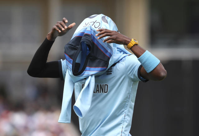 England's Jofra Archer wears his jersey after bowling an over during the Cricket World Cup match between England and Pakistan at Trent Bridge in Nottingham, Monday, June 3, 2019. (AP Photo/Rui Vieira)