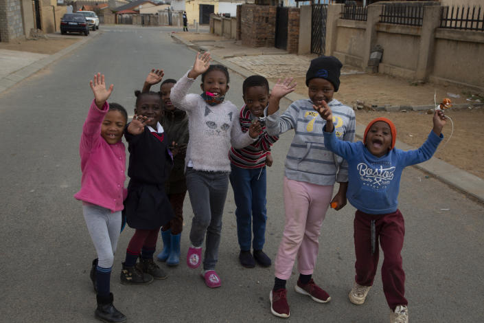 Children pose for a photo near the home of Gosiame Thamara Sithole in Tembisa, near Johannesburg, Thursday, June 10, 2021. South Africa is gripped by a mystery over if the woman, Sithole, has, as has been claimed, given birth to 10 babies in what would be a world-first case of decuplets. The South African government said Thursday it is still trying to verify the claim. (AP Photo/Denis Farrell)