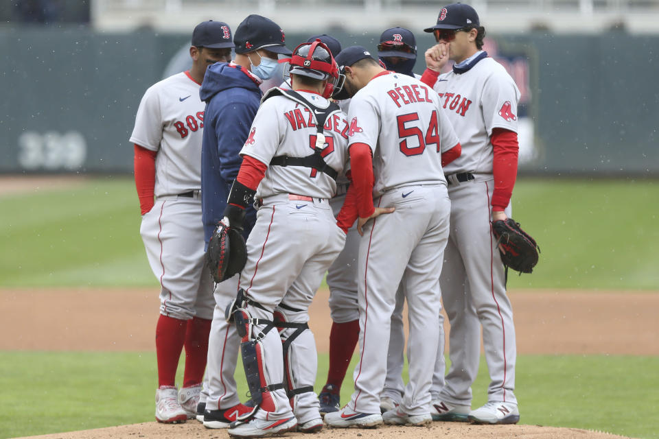 Boston Red Sox players meety at the mound during the first inning of a baseball game against the Minnesota Twins, Tuesday, April 13, 2021, in Minneapolis. (AP Photo/Stacy Bengs)