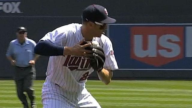 Trevor Plouffe gets ball stuck in his glove after diving stop