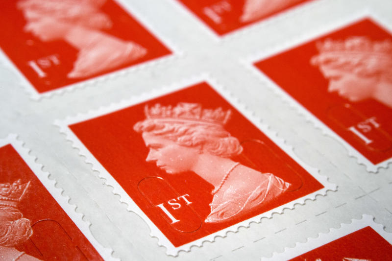 A sheet of first class stamps. Up to 60 Post Offices are set to be transferred to the private sector, which along with job cuts and pension changes has led to strikes by the CWU union