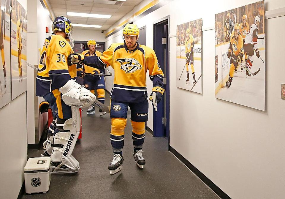 NASHVILLE, TN - OCTOBER 22: Frederick Gaudreau #32 taps goalie Marek Mazanec #39 of the Nashville Predators as he walks out for his first NHL game on October 22, 2016 at Bridgestone Arena against the Pittsburgh Penguins in Nashville, Tennessee. (Photo by John Russell/NHLI via Getty Images)