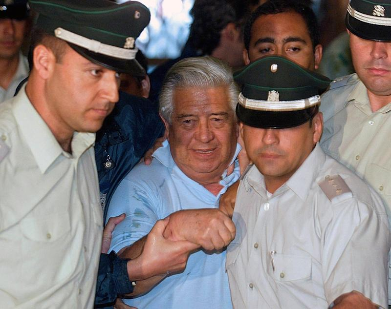 File picture from 2005 shows Manuel Contreras, the former head of Chile's feared intelligence service under the dictatorship of Augusto Pinochet, arriving in court in Santiago