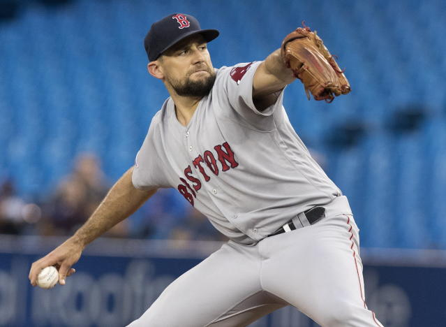 Boston Red Sox starting pitcher Nathan Eovaldi throws to a Toronto Blue Jays batter during the first inning of a baseball game Tuesday, Sept. 10, 2019, in Toronto. (Fred Thornhill/The Canadian Press via AP)