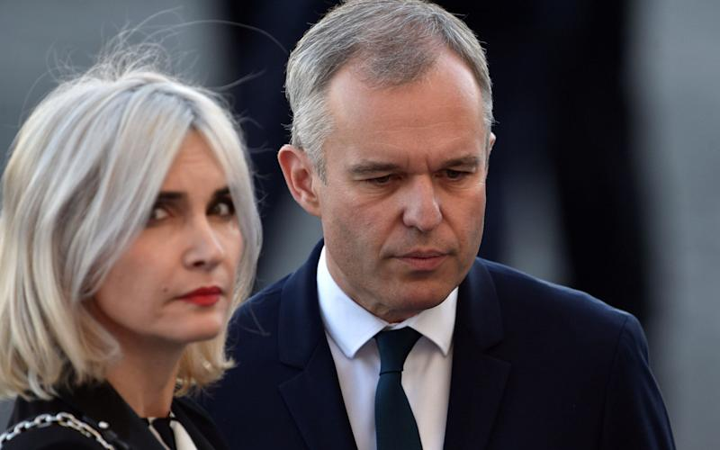 Francois de Rugy, seen here with his wife, French journalist Severine Servat, was criticised for his use of public funds - AFP
