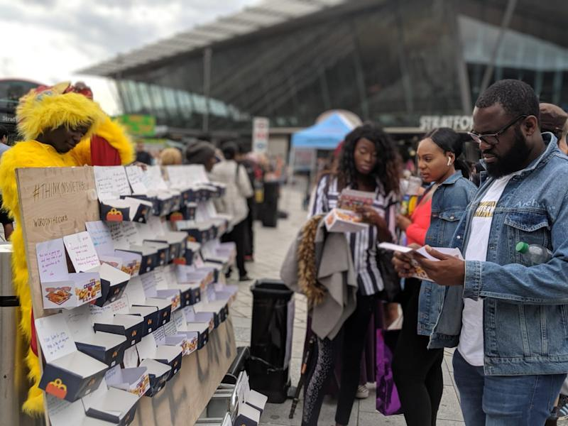 Londoners write messages for chicken boxes as part of Wartemberg and Uchea's #ThinkInsideTheBox campaign | Hayel Wartemberg