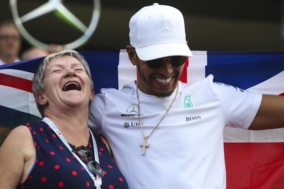Mum's the word: Lewis Hamilton laughing with his mother, Carmen Larbalestier, after the Mexican Grand Prix