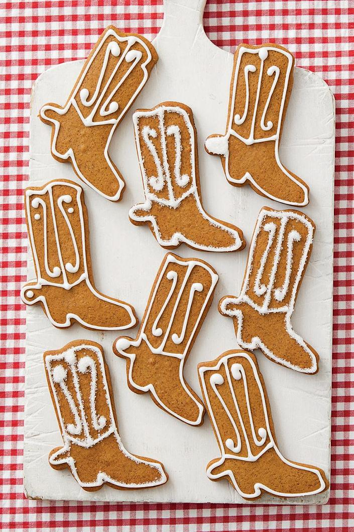 """<p>Whether you're throwing a ranch-themed harvest party or just looking for a cute cowboy-inspired treat, these gingerbread boots will have everyone saying """"yee-haw!""""</p><p><a href=""""https://www.thepioneerwoman.com/food-cooking/recipes/a34147770/gingerbread-cowboy-boot-cookies-recipe/"""" rel=""""nofollow noopener"""" target=""""_blank"""" data-ylk=""""slk:Get Ree's recipe."""" class=""""link rapid-noclick-resp""""><strong>Get Ree's recipe.</strong></a></p>"""