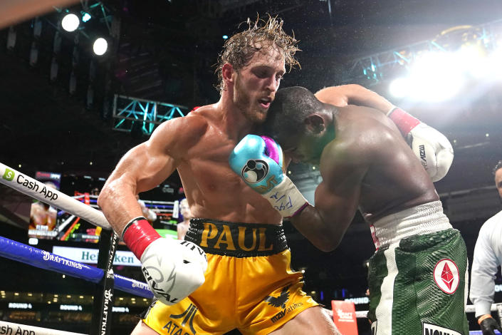 Logan Paul, left and Floyd Mayweather fight during an exhibition boxing match at Hard Rock Stadium, Sunday, June 6, 2021, in Miami Gardens, Fla. (AP Photo/Lynne Sladky)