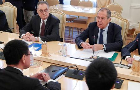 Russian Foreign Minister Sergei Lavrov (R) and his Japanese counterpart Taro Kono (L, front) attend a meeting in Moscow, Russia January 14, 2019. REUTERS/Maxim Shemetov