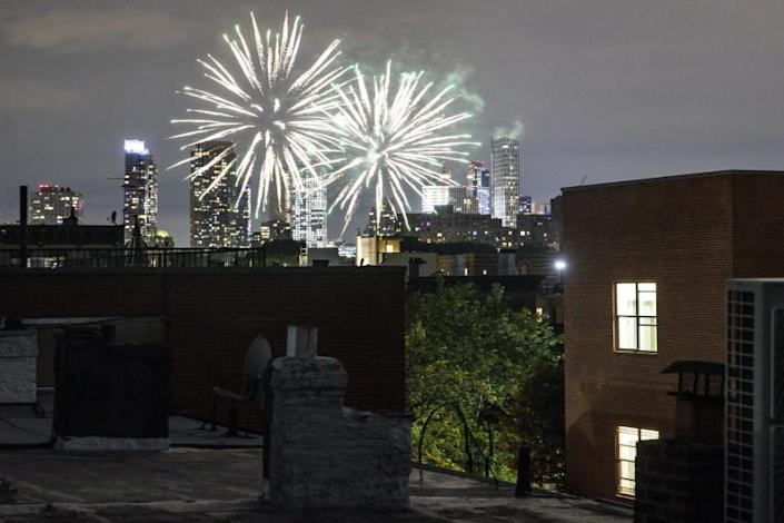 FILE - In this June 19, 2020, file photo fireworks explode during Juneteenth celebrations above the Bedford-Stuyvesant neighborhood in the Brooklyn borough of New York. The Manhattan skyline is seen in the background. (AP Photo/John Minchillo, File)