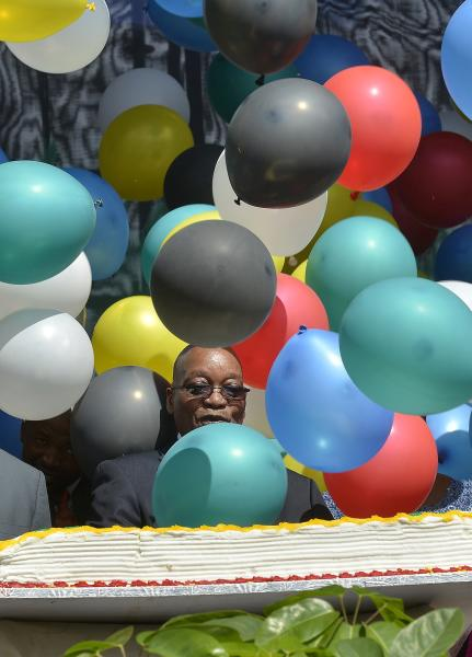 South Africa's President Zuma is seen behind balloons during Freedom Day celebrations in Pretoria