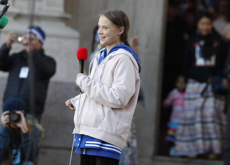 Swedish climate activist Greta Thunberg pulls her speech out of a pocket as she steps up to speak to several thousand people at a climate strike rally Friday, Oct. 11, 2019, in Denver. The rally was staged in Denver's Civic Center Park. (AP Photo/David Zalubowski)