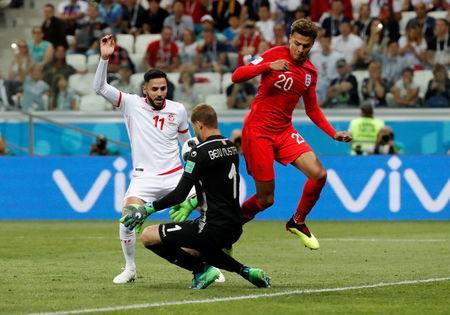 Soccer Football - World Cup - Group G - Tunisia vs England - Volgograd Arena, Volgograd, Russia - June 18, 2018 England's Dele Alli in action with Tunisia's Dylan Bronn and Farouk Ben Mustapha REUTERS/Jorge Silva