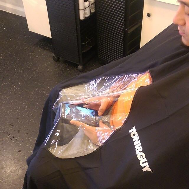 This Hair Salon's Cut-Out Cape Would Solve All of Our Texting Problems