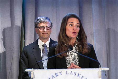 Microsoft co-founder Bill Gates listens to his wife Melinda speak after accepting an award from the Albert and Mary Lasker Foundation in New York