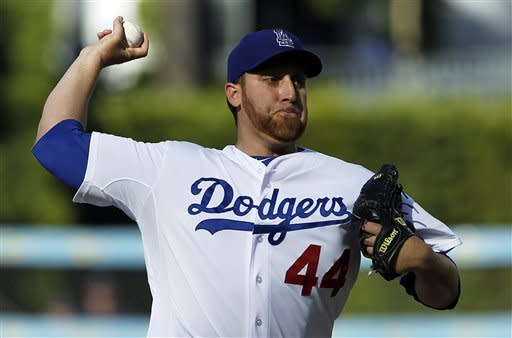 Los Angeles Dodgers starter Aaron Harang pitches to the Milwaukee Brewers in the first inning of a baseball game in Los Angeles Monday, May 28, 2012.(AP Photo/Reed Saxon)