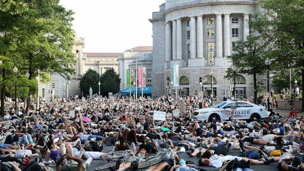 PHOTO: Demonstrators lay down at 15th St. and Pennsylvania Avenue during a peaceful protest against police brutality and the death of George Floyd, on June 3, 2020 in Washington, DC. (Tasos Katopodis/Getty Images)