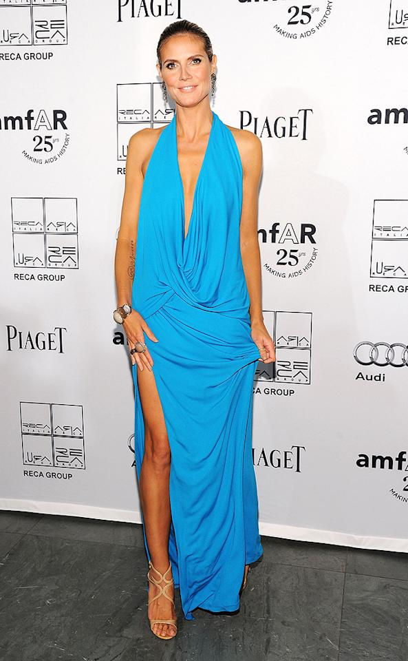 Supermodel mom Heidi Klum stepped out for an event at the Museum of Modern Art in New York wearing a plunging turquoise Michael Kors creation. (06/14/2011)