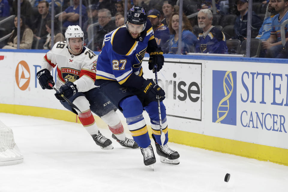 FILE - In this March 9, 2020, file photo, St. Louis Blues' Alex Pietrangelo (27) and Florida Panthers' Aleksi Saarela (28) chase after the puck during the first period of an NHL hockey game in St. Louis. The Vegas Golden Knights have agreed to terms on a $61.6 million, seven-year contract with top free agent Pietrangelo, a person with direct knowledge of the move tells The Associated Press. (AP Photo/Jeff Roberson, File)