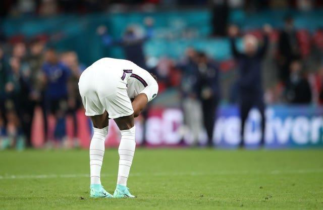 England's Marcus Rashford reacts after missing in the penalty shoot-out