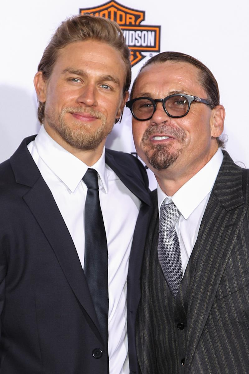 "Charlie Hunnam, left, and Kurt Sutter attend the LA Premiere Screening of ""Sons Of Anarchy"" at at TCL Chinese Theatre on Saturday, Sept. 6, 2014, in Los Angeles. (Photo by Paul A. Hebert/Invision/AP)"