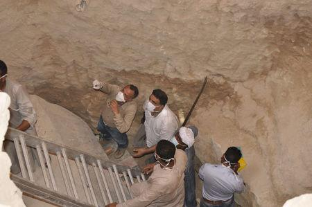 Mostafa Wazir, Secretary General of the Supreme Council of Antiquities, inspects the site of the newly discovered giant black sarcophagus in Sidi Gaber district of Alexandria, Egypt July 19, 2017 in this handout picture courtesy of the Ministry of Antiquities. The Ministry of Antiquities/Handout via Reuters