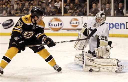 Pittsburgh Penguins goalie Marc-Andre Fleury stops a shot by Boston Bruins' Brad Marchand during the second period of an NHL hockey game in Boston, Saturday, Feb. 4, 2012. (AP Photo/Winslow Townson)
