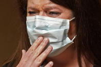 Denise Jones, a registered nurse, cries as she discusses the emotional toll of working in COVID-19 units, at at the Willis-Knighton Medical Center in Shreveport, La., Wednesday, Aug. 18, 2021. (AP Photo/Gerald Herbert)