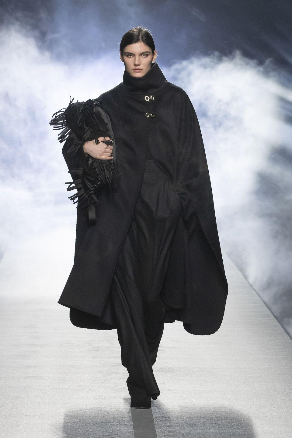 <p>All things comfy and cozy reached new heights in Alberta Ferretti's fall 2021 collection. The Italian designer, via video of a runway show, presented a lineup of cold-weather staples—blanket capes, shearling coats, cashmere sweaters, turtlenecks, and suede trousers—that, though roomy in cut, were tailored with precision and featured hand-stitched details. Ferretti started with black and charcoal-gray hues, gradually adding flesh tones, pine green, mustard yellow, robin's-egg blue, and shimmering gold. The overall vibe was relaxed minimalism with a dose of glamour. And though known primarily for being a red-carpet favorite, her recent offering proved that she is equally adept in creating luxe, no-fuss daywear. —<em>Barry Samaha </em></p>