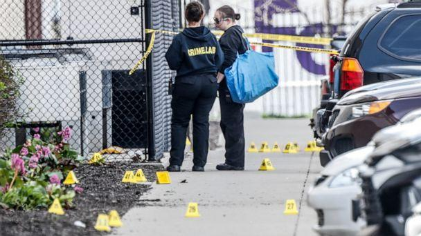 PHOTO: Investigators are on the scene following a mass shooting at a FedEx facility in Indianapolis, April 16, 2021. (Michelle Pemberton/The Indianapolis Star via USA Today Network)