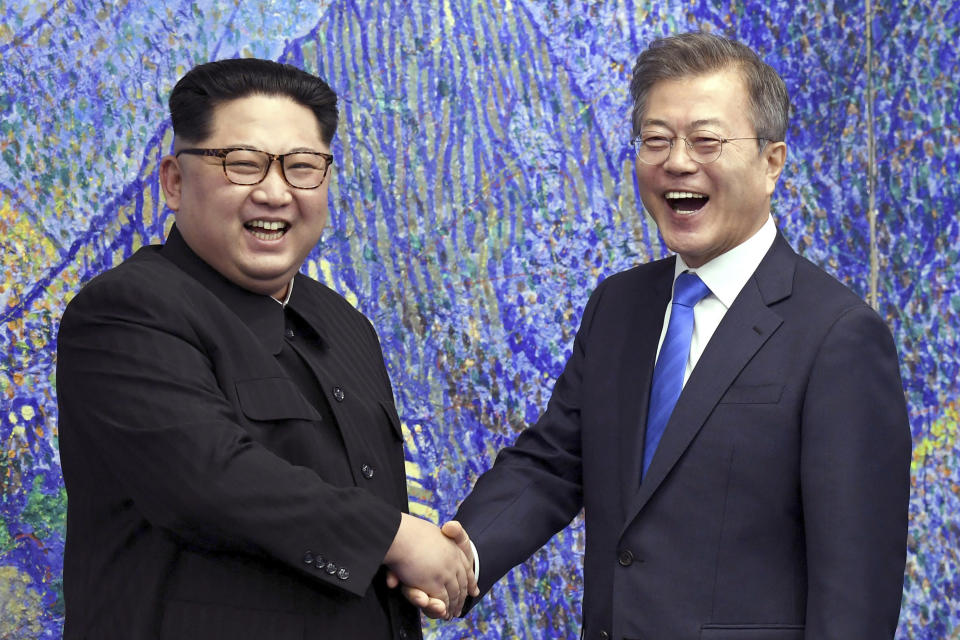 FILE - In this April 27, 2018, file photo, North Korean leader Kim Jong Un, left, poses with South Korean President Moon Jae-in for a photo inside the Peace House at the border village of Panmunjom in Demilitarized Zone, South Korea. The presidential office in Seoul said Tuesday, July 27, 2021, Moon and Kim have agreed to restore suspended communication channels and improve ties. (Korea Summit Press Pool via AP, File)