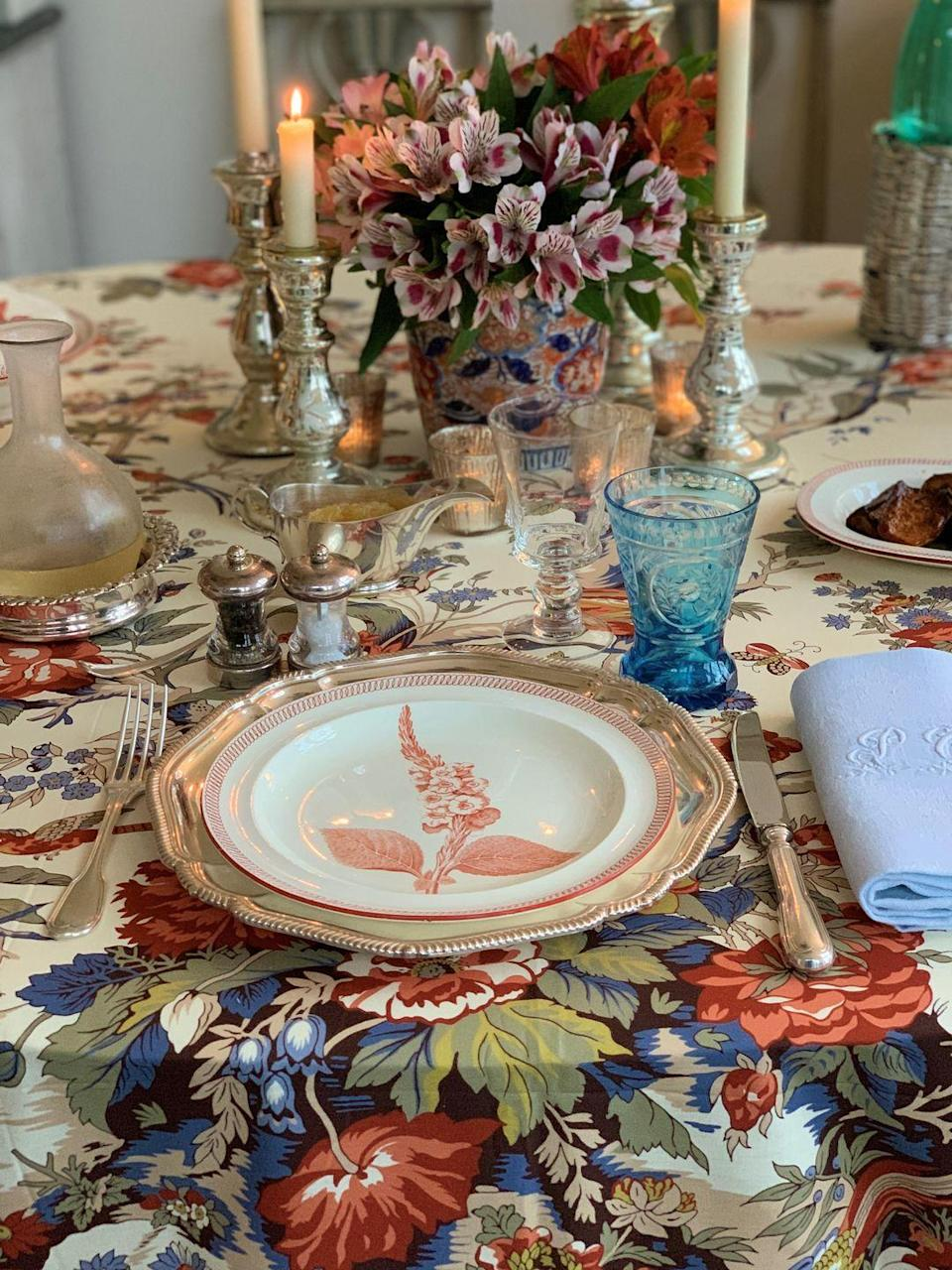 """<p>Paolo Moschino's fall tablescape includes a colorful antique statement vessel that perfectly compliments the patterned tablecloth, available soon online at <a href=""""https://nicholashaslam.com/"""" rel=""""nofollow noopener"""" target=""""_blank"""" data-ylk=""""slk:Paolo Moschino for Nicholas Haslam."""" class=""""link rapid-noclick-resp"""">Paolo Moschino for Nicholas Haslam.</a> </p>"""