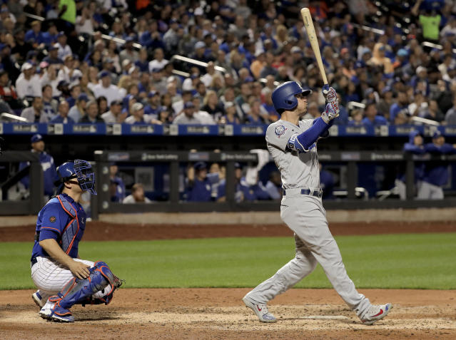 Los Angeles Dodgers' Cody Bellinger, right, follows through on a grand slam against the New York Mets during the sixth inning of a baseball game, Friday, June 22, 2018, in New York. (AP Photo/Julie Jacobson)