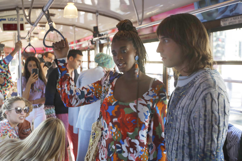Models wear creations onboard a tram as part of the Missoni Spring-Summer 2020 collection, unveiled during the fashion week, in Milan, Italy, Thursday, Sept. 19, 2019. (AP Photo/Luca Bruno)