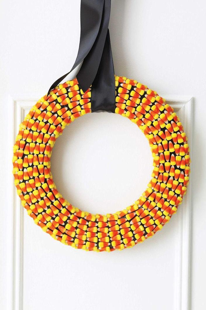 """<p>If you have <em>way too much</em> candy corn lying around, create this colorful wreath before the kids snack on them.</p><p><em><a href=""""https://www.womansday.com/home/crafts-projects/how-to/a5283/halloween-craft-candy-corn-wreath-111103/"""" rel=""""nofollow noopener"""" target=""""_blank"""" data-ylk=""""slk:Get the tutorial for Candy Corn Wreath."""" class=""""link rapid-noclick-resp"""">Get the tutorial for Candy Corn Wreath.</a></em></p><p><strong>What You'll Need</strong>: <a href=""""https://www.amazon.com/Oh-Gourmet-Halloween-Wholesale-Pricing/dp/B07HJGJVQQ/ref=sr_1_2_sspa?crid=2K5LSEI6LSTR8&keywords=candy+corn+bulk&qid=1563293290&s=gateway&sprefix=candy+corn+b%2Caps%2C119&sr=8-2-spons&psc=1&tag=syn-yahoo-20&ascsubtag=%5Bartid%7C10070.g.2488%5Bsrc%7Cyahoo-us"""" rel=""""nofollow noopener"""" target=""""_blank"""" data-ylk=""""slk:Candy corn"""" class=""""link rapid-noclick-resp"""">Candy corn</a> ($15 for 4 LB bag, Amazon)</p>"""