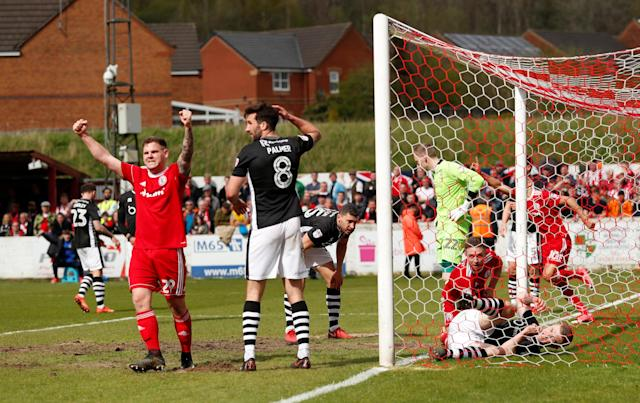 "Soccer Football - League Two - Accrington Stanley v Lincoln City - Wham Stadium, Accrington, Britain - April 28, 2018 Accrington Stanley's Billy Kee (L) celebrates as Jordan Clark (on goal line) scores their first goal Action Images/Andrew Boyers EDITORIAL USE ONLY. No use with unauthorized audio, video, data, fixture lists, club/league logos or ""live"" services. Online in-match use limited to 75 images, no video emulation. No use in betting, games or single club/league/player publications. Please contact your account representative for further details."