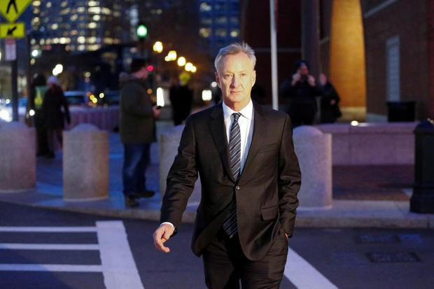 Title insurance executive Toby MacFarlane leaves the federal courthouse in Boston